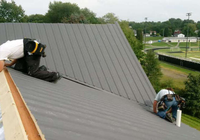 Metal Roof Installation Over ThermoBuilt Roof-50 System.